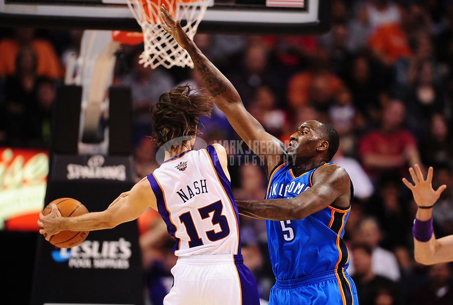 Mar. 30, 2011; Phoenix, AZ, USA; Oklahoma City Thunder center (5) Kendrick Perkins defends Phoenix Suns guard (13) Steve Nash at the US Airways Center. Mandatory Credit: Mark J. Rebilas-