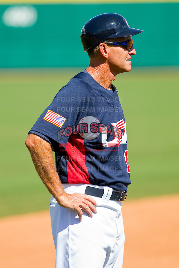 Team USA coach Roly de Armas #13 coaches third base during the exhibition game against Team Canada at the USA Baseball National Training Center on September 29, 2011 in Cary, North Carolina.  (Brian Westerholt / Four Seam Images)