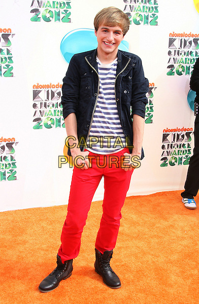 Lucas Cruikshank.2012 Nickelodeon Kids' Choice Awards held at the Galen Center, Los Angeles, California, USA..March 31st, 2012.full length white striped stripes jacket top black jeans denim red .CAP/ADM.©AdMedia/Capital Pictures.