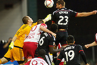 DC United's Perry Kitchen skies above everyone to head the ball and score his first goal of the night. Red Bull NY rallied back to tie DC United 2-2 at RFK Stadium in Washington D.C. on Saturday April 11, 2015.