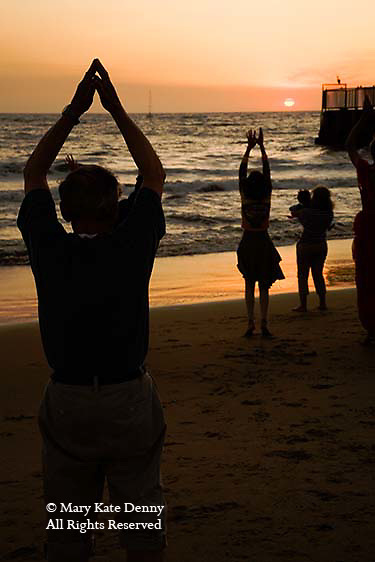 NIA exercise dance class with seniors of men and women performs at sunset on Playa del Rey beach in Los Angeles county