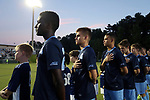 CARY, NC - OCTOBER 06: UNC's Jelani Pieters, Alan Winn, and Zach Wright during the playing of the national anthem. The University of North Carolina Tar Heels hosted the Wake Forest University Demon Deacons on October 6, 2017 at Koka Booth Field at WakeMed Soccer Park in Cary, NC in a Division I college soccer game.