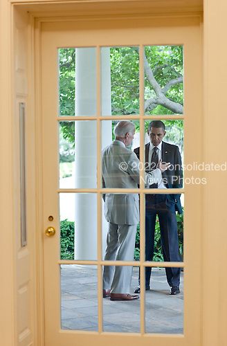 United States President Barack Obama talks with U.S. Vice President Joe Biden on the Colonnade of the White House outside the Oval Office, June 20, 2011..Mandatory Credit: Pete Souza - White House via CNP