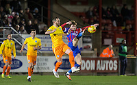 Oliver Muldoon of Dagenham & redbridge beats Paul Hayes of Wycombe Wanderers to the ball during the Sky Bet League 2 match between Dagenham and Redbridge and Wycombe Wanderers at the London Borough of Barking and Dagenham Stadium, London, England on 9 February 2016. Photo by Andy Rowland.