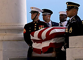 WASHINGTON, DC - DECEMBER 03: A military honor guard team carries the casket of former U.S. President George H. W. Bush into the U.S. Capitol December 3, 2018 in Washington, DC. A state funeral for former U.S. President Bush will be held in Washington over the next three days, beginning with him lying in state in the Rotunda of the Capitol until Wednesday morning. (Photo by Win McNamee/Getty Images)