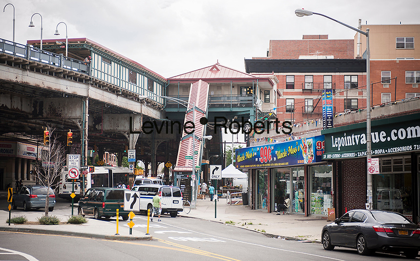 Businesses around the Freeman Street elevated train station in the Bronx borough of New York is seen on Saturday, July 26, 2014.  (© Richard B. Levine)