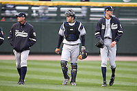 Scranton Wilkes-Barre Yankees catcher Jesus Montero #21 walks in from the bullpen with Andrew Brackman #40 and pitching coach Scott Aldred (left) before a game against the Rochester Red Wings at Frontier Field on April 12, 2011 in Rochester, New York.  Scranton defeated Rochester 5-3.  Photo By Mike Janes/Four Seam Images