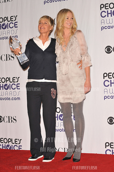 Ellen Degeneres & Portia DeRossi (right) at the 2009 People's Choice Awards at the Shrine Auditorium, Los Angeles..January 7, 2009  Los Angeles, CA.Picture: Paul Smith / Featureflash