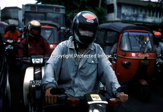 Motorcycles and cars in rush hour on February 26, 1998 in central Jakarta, Indonesia. Indonesia was hit by economic turmoil during the emerging market crisis of 1998, and the currency, the rupiah, lost a lot of its value. Many people lost their jobs and many from the country side came to the big cities to look for work. .(Photo: Per-Anders Pettersson/ Liaison Agency)