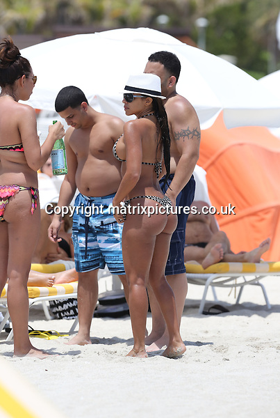 NON EXCLUSIVE PICTURE: MATRIXPICTURES.CO.UK.PLEASE CREDIT ALL USES..UK, AUSTRALIA, NEW ZEALAND AND ASIA RIGHTS ONLY..Cuban glamour model Vida Guerra is spotted wearing a sexy two-piece bikini on Florida's Miami Beach...APRIL 26th 2013..REF: KDA 132803..XIM