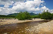 East Branch of the Pemigewasset River in Lincoln, New Hampshire during the summer months. Big Coolidge Mountain can be seen between the group of trees.