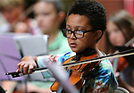 Deandre Paplia, 11, performs in the Carson City Symphony's Youth Strings Summer Program concert in Carson City, Nev., on Thursday, July 27, 2017. <br />