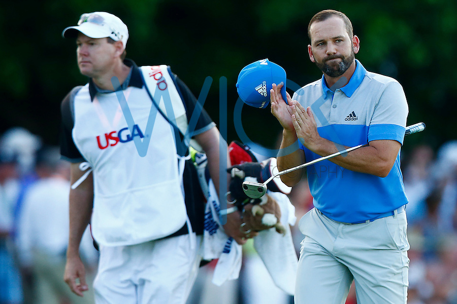 Sergio Garcia acknowledges the fans on his way to the 18th green during the 2016 U.S. Open in Oakmont, Pennsylvania on Sunday June 19, 2016. (Photo by Jared Wickerham / DKPS)