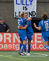 Goal scorer Boston Breakers defender Jordan Angeli (4) celebrates with Boston Breakers midfielder Lindsay Tarpley (5). Sky Blue FC defeated the Boston Breakers, 2-1, at Harvard Stadium on June 13, 2010.