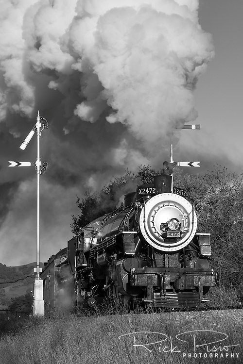 Southern Pacific 2472 passes by the signal arms near the Sunol Depot in Niles Canyon. Built by the Baldwin Locomotive Works in 1921, and used by the Southern Pacific Railroad until its retirement in 1956, No. 2467 was restored to operation by the Pacific Locomotive Association in 1999. The 4-6-2, 150 ton steam locomotive now runs through Niles Canyon as part of the Niles Canyon Railway.