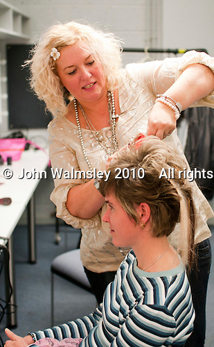 "One of the volunteer hairdressers at work.  Special Olympics Surrey put on a show,   ""Beyond the Stars"", at the Rose Theatre, Kingston upon Thames to raise money for the  SOGB team.  The Special Olympics are for athletes with learning disabilities."