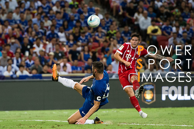 Chelsea Defender Gary Cahill (L) try to defend a kick from Bayern Munich Midfielder James Rodríguez (R) during the International Champions Cup match between Chelsea FC and FC Bayern Munich at National Stadium on July 25, 2017 in Singapore. Photo by Marcio Rodrigo Machado / Power Sport Images