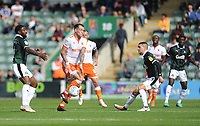 Blackpool's Harry Pritchard vies for possession with Plymouth Argyle's Yann Songo'o<br /> <br /> Photographer Kevin Barnes/CameraSport<br /> <br /> The EFL Sky Bet League One - Plymouth Argyle v Blackpool - Saturday 15th September 2018 - Home Park - Plymouth<br /> <br /> World Copyright &copy; 2018 CameraSport. All rights reserved. 43 Linden Ave. Countesthorpe. Leicester. England. LE8 5PG - Tel: +44 (0) 116 277 4147 - admin@camerasport.com - www.camerasport.com