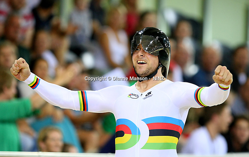 Southland's Eddie Dawkins celebrates finishing first in the team sprint at the BikeNZ Elite & U19 Track National Championships, Avantidrome, Home of Cycling, Cambridge, New Zealand, Sunday, March 16, 2014. Credit: Dianne Manson