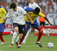 English midfielder (16) Owen Hargreaves tries to take the ball away from Ecuadorian forward (11) Agustin Delgado.  England defeated Ecuador, 1-0, in their FIFA World Cup round of 16 match at Gottlieb-Daimler-Stadion in Stuttgart, Germany, June 25, 2006.