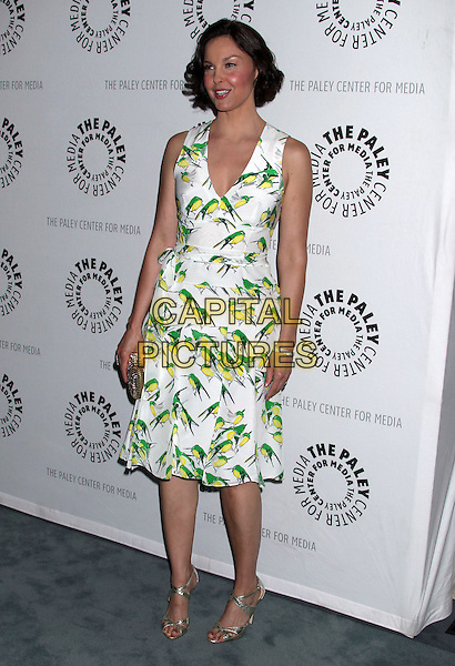 "Ashley Judd.""Missing"" Premiere Screening presented by The Paley Center for Media held at The Paley Center For Media, Beverly Hills, California, USA..April 10th, 2012.full length white green print dress bird birds gold clutch bag  .CAP/ADM/RE.©Russ Elliot/AdMedia/Capital Pictures."