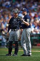 Milwaukee Brewers catcher Jonathan Lucroy (20) and pitcher Tyler Cravy (45) during a game against the Chicago Cubs on August 13, 2015 at Wrigley Field in Chicago, Illinois.  Chicago defeated Milwaukee 9-2.  (Mike Janes/Four Seam Images)