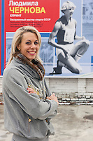 Krasnodar, Russia, 16/03/2009..World champion heptathlete Tatyana Chernova with a poster of her mother Ludmilla, who won gold at the 1980 Moscow Olympic Games, at the stadium where she trains. Chernova, who won bronze in the Beijing Olympic Games, is tipped for gold in London.