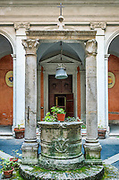 Courtyard and well outside the church of Saint Agata of Goti, Rome, Italy