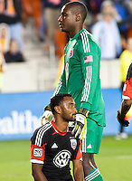 Bill Hamid (GK) of D.C United comforts James Riley of D.C United, after a goal is scored at BBVA Compass Stadium. Houston beat D.C United, 2-0 in the MLS season opener.
