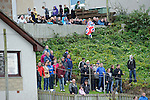 Rangers fans watching the game from somebody's front garden overlooking Mosset Park