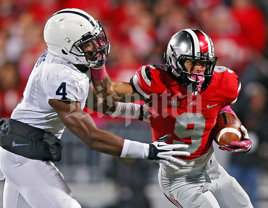 Ohio State Buckeyes wide receiver Devin Smith (9) tries to get past Penn State Nittany Lions safety Adrian Amos (4) after a catch in the 2nd quarter at Ohio Stadium on October 26, 2013.  (Dispatch photo by Kyle Robertson)