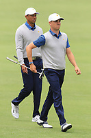 Tiger Woods (USA) and Justin Thomas (USA) on the 4th fairway during the Second Round - Foursomes of the Presidents Cup 2019, Royal Melbourne Golf Club, Melbourne, Victoria, Australia. 13/12/2019.<br /> Picture Thos Caffrey / Golffile.ie<br /> <br /> All photo usage must carry mandatory copyright credit (© Golffile | Thos Caffrey)