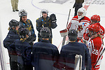 ADRIAN, MI - MARCH 18: Game officials huddle with team captains before the Division III Women's Ice Hockey Championship held at Arrington Ice Arena on March 19, 2017 in Adrian, Michigan. Plattsburgh State defeated Adrian 4-3 in overtime to repeat as national champions for the fourth consecutive year. (Photo by Tony Ding/NCAA Photos via Getty Images)