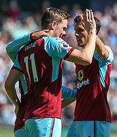 Burnley's Chris Wood celebrates scoring his side's first goal with teammate Jack Cork<br /> <br /> Photographer Alex Dodd/CameraSport<br /> <br /> The Premier League - Burnley v Bournemouth - Sunday 13th May 2018 - Turf Moor - Burnley<br /> <br /> World Copyright &copy; 2018 CameraSport. All rights reserved. 43 Linden Ave. Countesthorpe. Leicester. England. LE8 5PG - Tel: +44 (0) 116 277 4147 - admin@camerasport.com - www.camerasport.com