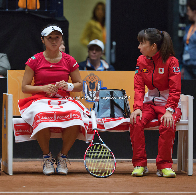 The Netherlands, Den Bosch, 16.04.2014. Fed Cup Netherlands-Japan, Japanese captain Yuka Kaneko on the bench with Misaki Doi<br /> Photo:Tennisimages/Henk Koster
