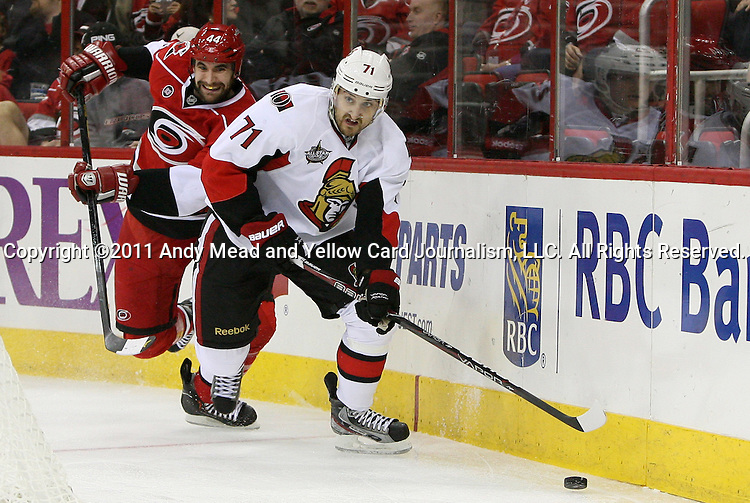 23 December 2011: Ottawa's Nick Foligno (71) and Carolina's Jay Harrison (44). The Carolina Hurricanes defeated the Ottawa Senators 2-1 in overtime at the RBC Center in Raleigh, North Carolina in a 2011-2012 National Hockey League regular season opening game.