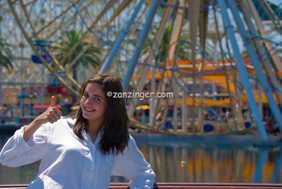 Teenager smiling, thumbs up, Sun Wheel, Disney's California Adventure, Disneyland, Anaheim, California, usa