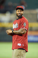 Arizona Diamondbacks guest Darnell Dockett #90 of the Arizona Cardinals throws out a first pitch before a National League regular season game against the Colorado Rockies at Chase Field on October 2, 2012 in Phoenix, Arizona. Arizona defeated Colorado 5-3. (Mike Janes/Four Seam Images)