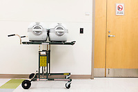 Empty LifePort Kidney Transporters, also known as kidney pumps, wait to be used in a hallway at the New England Organ Bank, an organ procurement organization based in Waltham, Massachusetts, serving the greater New England area. The devices help keep donated kidneys viable during transportation.