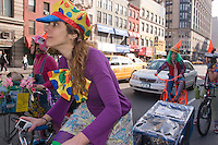 New York, NY - 15 March 2008 - BIKE LANE LIBERATION CLOWN RIDE - A  troop of cyclists dressed like clowns warn drivers illegally parked in Manhattan's bike lanes. Some clowns rode re-purposed DKNY Advertising bikes.