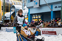 Bailey Schaeffer and team leave the ceremonial start line with an Iditarider and handler at 4th Avenue and D street in downtown Anchorage, Alaska on Saturday March 3rd during the 2018 Iditarod race. Photo ©2018 by Brendan Smith/SchultzPhoto.com