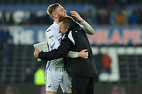 Oli McBurnie of Swansea City celebrates at full time with Billy Reid, assistant manager for Swansea during the Sky Bet Championship match between Swansea City and Sheffield United at the Liberty Stadium in Swansea, Wales, UK. Saturday 19 January 2019