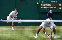 London, England, 30 june, 2016, Tennis, Wimbledon, Men's doubles: Horacia Tacau (ROU) and his partner Jean-Julien Rojer (NED) (L)<br /> Photo: Henk Koster/tennisimages.com