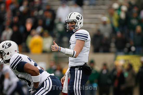 Trent Nelson  |  The Salt Lake Tribune.BYU quarterback Jake Heaps (9) gives a thumbs up to his offense in the first quarter. BYU vs. Colorado State, college football, Saturday, November 13, 2010.