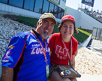 Jun 7, 2015; Englishtown, NJ, USA; NHRA team PR rep Rob Geiger with his daughter during the Summernationals at Old Bridge Township Raceway Park. Mandatory Credit: Mark J. Rebilas-