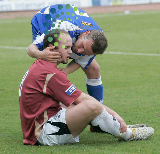 Ayr United player No8 Dean Keenan dejected as Kevin Finlayson talks to him after Ayr United go down during Morton fc v Ayr United game at Cappielow Park, Greenock..1 May 2010 Picture: Universal News And Sport (Europe)...