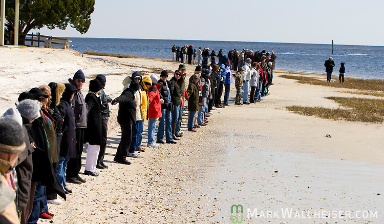 This group of 130 gathered at Shell Point Beach south of Tallahassee, Florida to participate in the statewide Hands Across the Sand event February 13, 2010. The event was to protest proposed legislation to allow oil drilling off the coast and beaches of Florida.