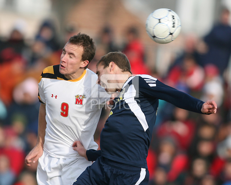 Jason Herrick #9 of the University of Maryland goes for a header against Brian Klemczak #15 of the University of Michigan during an NCAA quarter-final match at Ludwig Field, University of Maryland, College Park, Maryland on December 4 2010.Michigan won 3-2 AET.