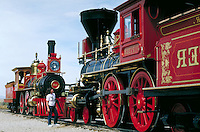tourist viewing locomotives at Promontory National Historic Site. Engines, trains. tourist. Promontory Utah USA.