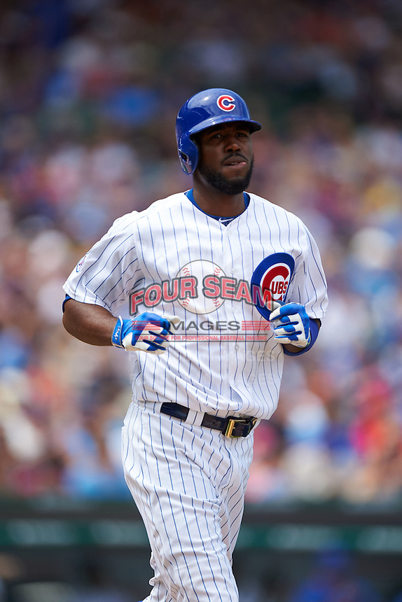 Chicago Cubs outfielder Dexter Fowler (24) jogs to first during a game against the Milwaukee Brewers on August 13, 2015 at Wrigley Field in Chicago, Illinois.  Chicago defeated Milwaukee 9-2.  (Mike Janes/Four Seam Images)